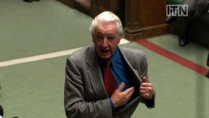 Dennis shouting about his United Nations heart bypass in Parliament