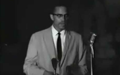 Malcomb making a speech in his last year of life before being assassinated